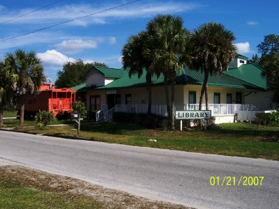 Umatilla Florida: Umatilla Public Library with retired Atlantic Coast Line Caboose